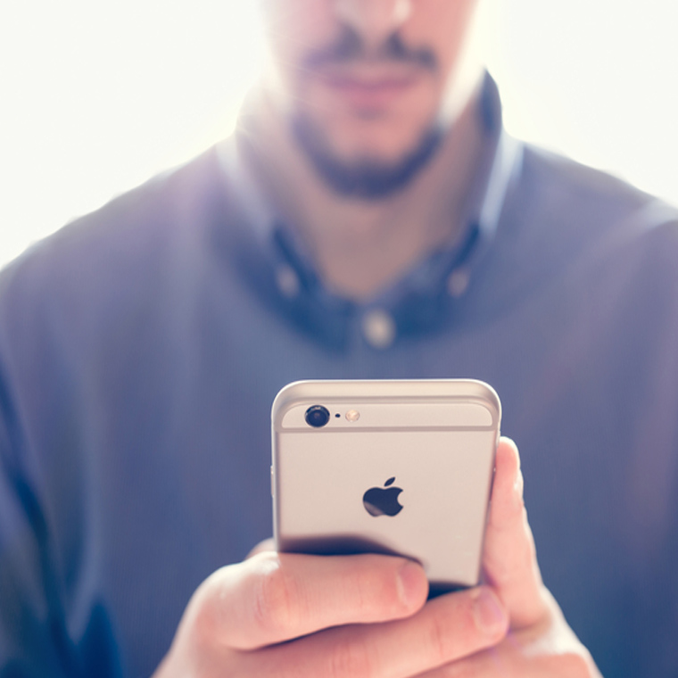 person holding apple smartphone