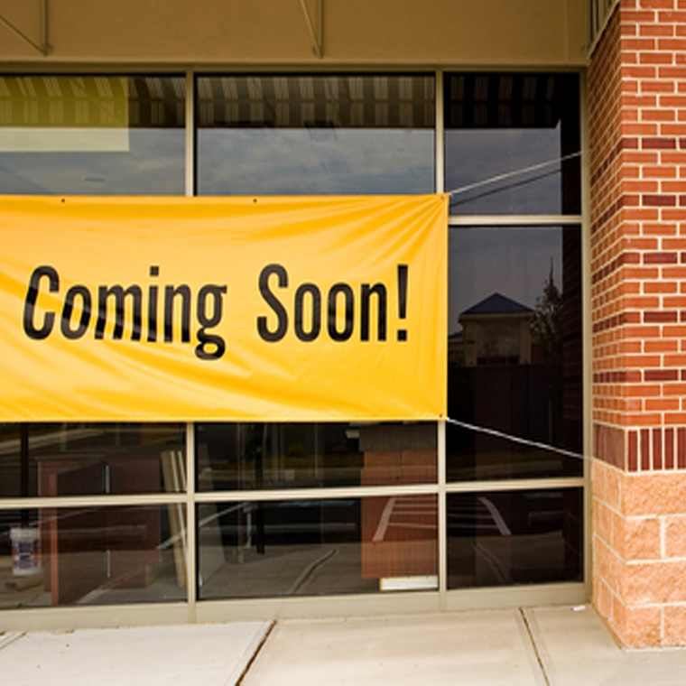 storefront sign says coming soon
