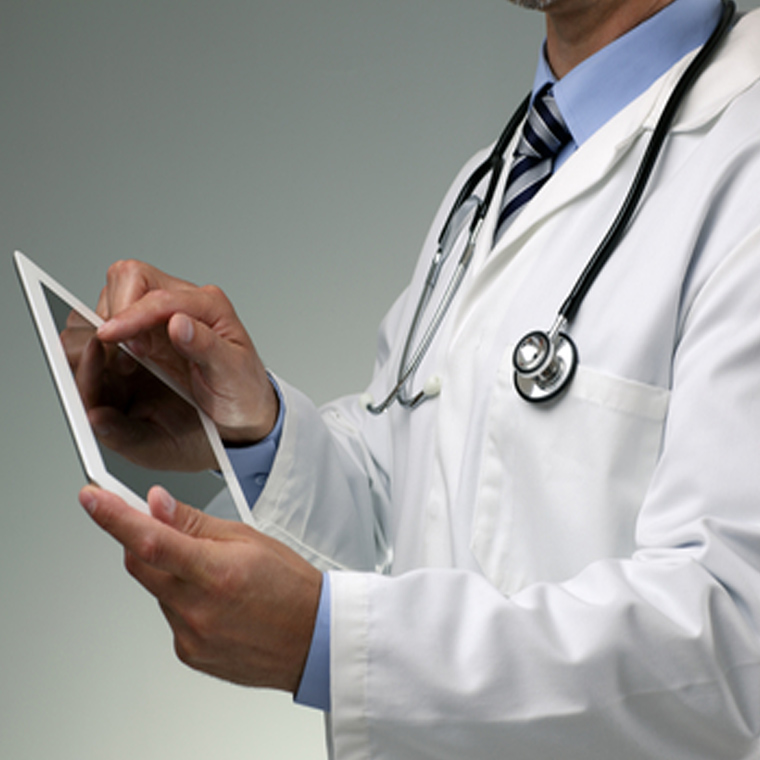 doctor holding an electronic patient record