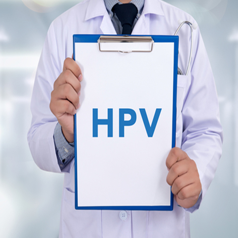 Doctor holding sign with HPV on it