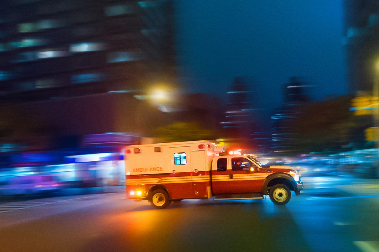 Ambulance driving through city